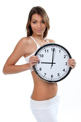 Woman in white underwear with a clock showing 9 o'clock