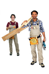 Two carpenters working together