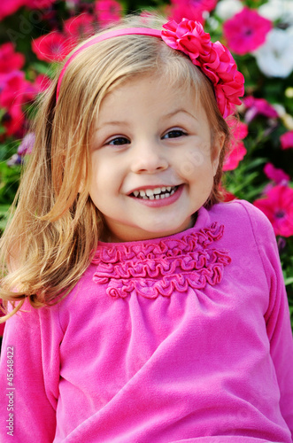 Little Girl in Pink by Pink Flowers