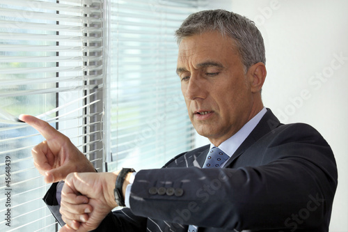 Senior businessman checking the time