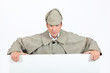 Man in deerstalker and cape leaning on a board
