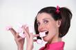 Brunette eating marshmallow sweets
