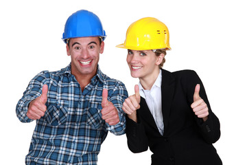 craftsman and businesswoman thumbs up
