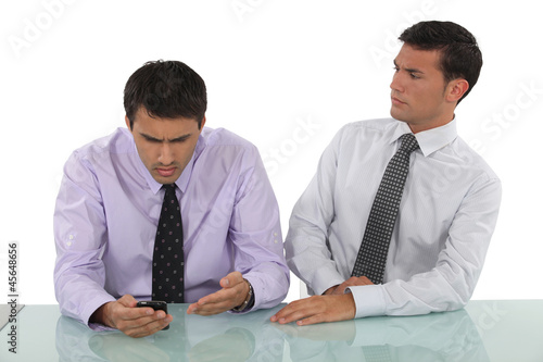 Expressive businessmen sitting at a desk