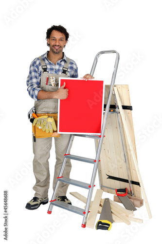 Carpenter giving the thumbs up to a board