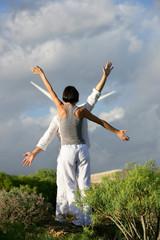 Couple stood mimicking wind farm