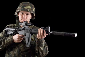 Alerted soldier holding m16