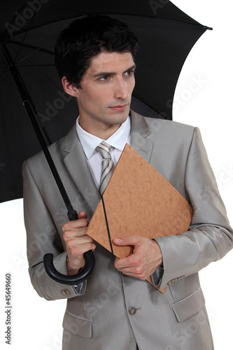 Businessman with an umbrella