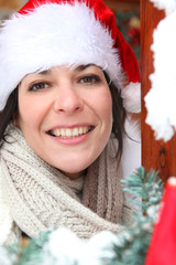 Woman answering the door in festive hat