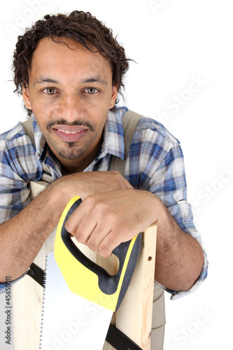 Portrait of a carpenter with a saw