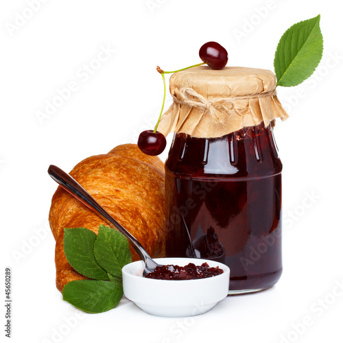 Cherry jam with croissants and juice isolated