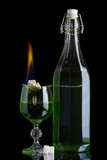 Absinthe bottle and glass with lump sugar burning poster