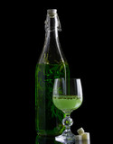Absinthe with sugar bottle and glass isolated on black poster