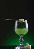 Glass of absinthe with spoon and lump sugar poster