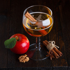 apple cider still life with cinnamon stick