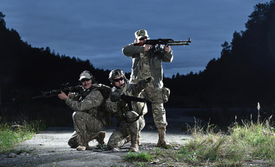 NATO soldiers in full gear. In a defensive posture.