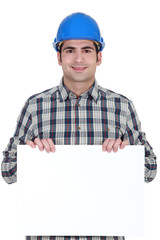craftsman holding a blank poster
