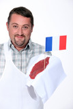Butcher holding French beef