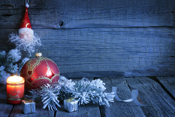 Christmas vintage background with candle and bauble in night