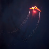 Hang glider in the night. poster
