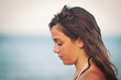 Portrait of young girl on the beach. Shallow depth of field.