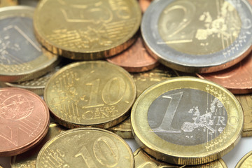 Euro coins. One Euro coin on the foreground. Shallow DOF
