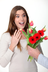 Woman receiving bouquet of flowers