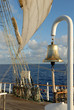 Romantic Sailing. Bell and sea sail on the ocean background