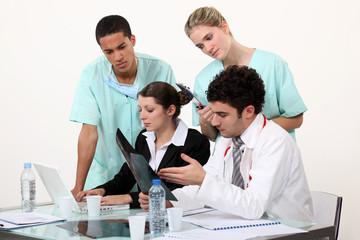 Medical staff gathered by desk