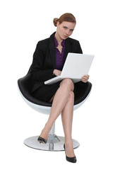 Woman sat in designer chair with laptop