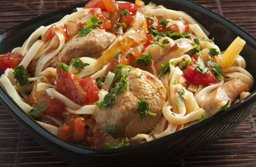 Italian pasta with tomatoes and meat close up