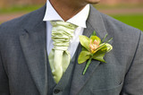Fototapety groom with orchid buttonhole at wedding