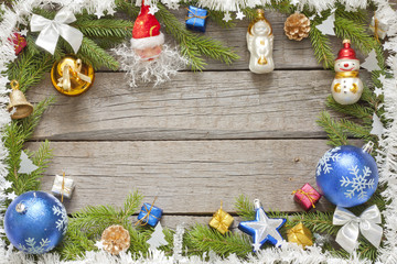 Christmas background border with baubles on wooden boards