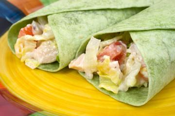 Close view chicken salad spinach wraps