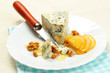 Pear, blue cheese and walnuts on a plate