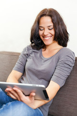Cheerful woman and electronic tablet