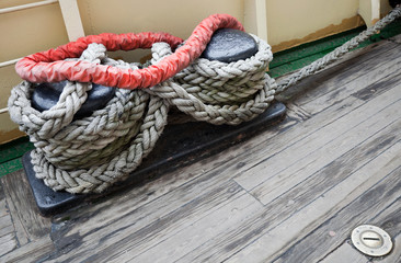 Bundle of rope on the black mooring bollard