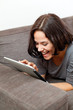 Happy woman with electronic tablet