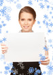 happy teenage girl with blank board
