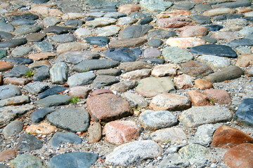 Road made ​​with multicolored stones.