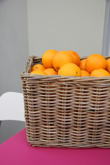 Wicker basket with oranges