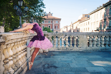 Young beautiful ballerina dancing in Bologna - Pincio, Italy.