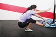 Young Woman Exercising on gym