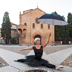 Young beautiful ballerina posing in front of St. Stephen church