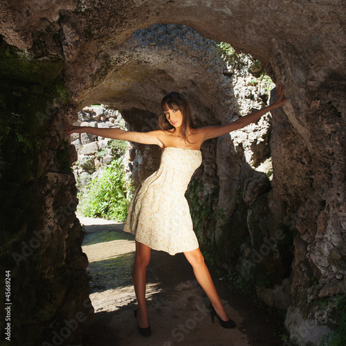 Full body beautiful girl portrait inside a cave.
