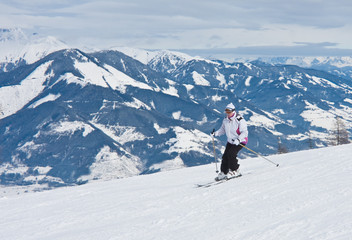 A woman is skiing at a ski resort
