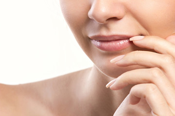 closeup portrait of woman's lips and hand