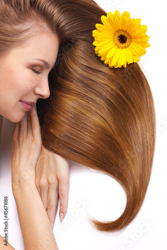 young woman with long shining hair sleep