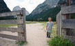 Portrait of four year old boy outdoors in the mountains. Dolomit
