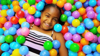 Cute African American Girl Enjoying Ball Pool